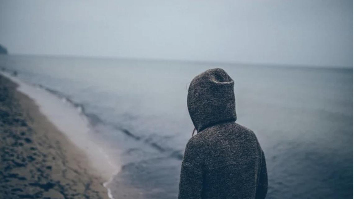 Man on a beach alone